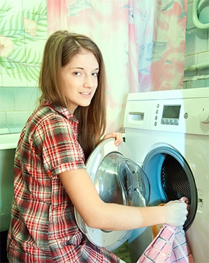 Teenager Unloading Washing Machine